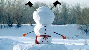 snowman doing headstand in snowy forest